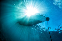 Free Boat Ship From Underwater Blue Ocean With Sun Rays Royalty Free Stock Photos - 72174358
