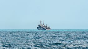 Boat or ship navigating on blue Black Sea water, cargoboat Stock Image