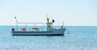 Boat or ship navigating on blue Black Sea water, entertaiment yacht.  Royalty Free Stock Photos