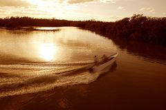 Boat ship wake prop wash sunset lake river Royalty Free Stock Photography