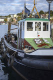 Boat ship in the water parked next to one small harbor. Old redecorated and restored ship that is still in transportation Royalty Free Stock Image