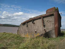Boat - Shipwrecked. A shipwrecked boat in the Purton Hulks Graveyard, Gloucestershire royalty free stock image