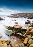 Boat shipwrecked on the coast. In a long exposure photo Royalty Free Stock Photos