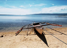 Boat on shore. Boat ashore, to explore a new island Royalty Free Stock Image