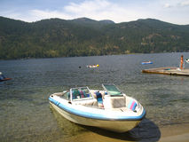 Boat on the shore. A new boat docked, waiting to go Royalty Free Stock Photo