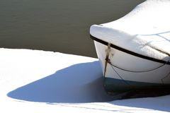 Boat on the shore of the Borcea arm. Landscape stories in the winter season on the Borcea branch Royalty Free Stock Photos