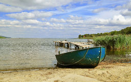 A boat on the shore of the Dnepr river Stock Images