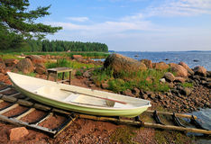 Boat on the shore in Finland Stock Photos
