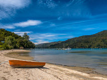 Boat on the Shore of a Fiord in Marlborough Sounds, South Island Stock Image