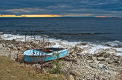 Boat on the shore of Lake Baikal Royalty Free Stock Images