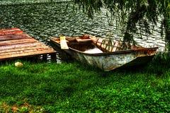 Boat at shore. Of lake, by the pontoon Royalty Free Stock Photos
