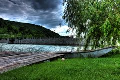 Boat at shore. Of lake, by the pontoon Royalty Free Stock Images