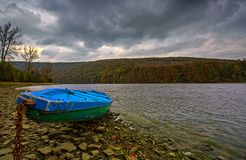 A boat on the shore of Lake Solina. In the Bieszczady mountains stock images
