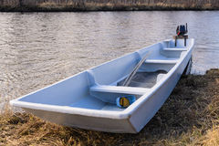 Boat on the shore of a mountain river. Royalty Free Stock Photo