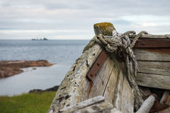 Boat on the shore, north, Russia. An old fishing vessel on the shore of the White Sea in the north of Russia Royalty Free Stock Images