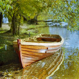 Boat at the shore of a river stock photography
