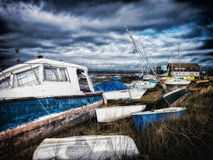 Boat on the shore under a stormy sky Royalty Free Stock Photography