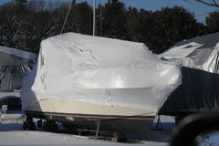 Boat with Shrink Wrap. Boat with a coat of shrink-wrap , protection from winter elements in North America Royalty Free Stock Images
