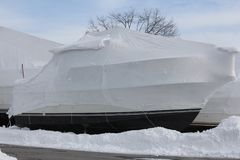 Boat with Shrink Wrap. Boat with a coat of shrink-wrap , protection from winter elements in North America Royalty Free Stock Photo