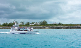 Boat shuttling tourists to Coco Cay Bahamas private tropical is. COCO CAY, BAHAMAS - OCT 16, 2016: Royal Caribbean`s Ship 2 Shore Boat shuttling tourists to Coco Stock Photo