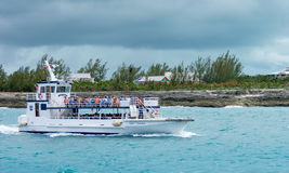Boat shuttling tourists to Coco Cay Bahamas private tropical is. COCO CAY, BAHAMAS - OCT 16, 2016: Royal Caribbean`s Ship 2 Shore Boat shuttling tourists to Coco Stock Image