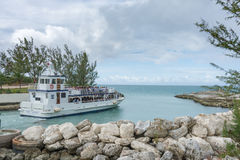 Boat shuttling tourists to Coco Cay Bahamas private tropical is. COCO CAY, BAHAMAS - OCT 16, 2016: Royal Caribbean`s Ship 2 Shore Boat shuttling tourists to Coco Stock Photography
