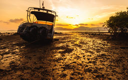 Boat side on the beach with color of sunset Royalty Free Stock Photography
