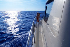 Boat side sailing in blue sea sun reflection Royalty Free Stock Photography
