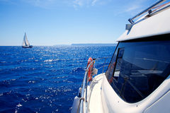 Boat side view of blue ocean with sailboat Stock Images