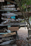 Boat signs and name plates with shells decorating a driftwood hut in Canada`s Inside Passage Royalty Free Stock Photography