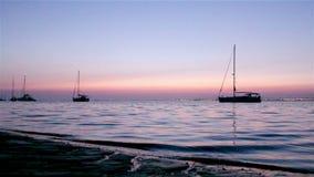 Boat silhoette at dawn in Ria Formosa. Algarve stock video footage