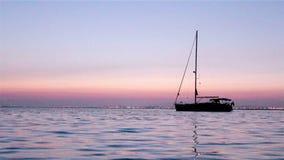 Boat silhoette at dawn in Ria Formosa. Algarve stock footage