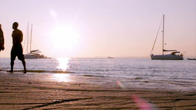 Boat silhoette at sunset in, Ria Formosa. Algarve stock video