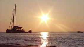 Boat silhoette at sunset in, Ria Formosa. Algarve stock video footage