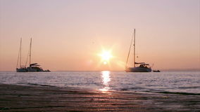 Boat silhoette at sunset in Ria Formosa. Algarve Stock Photography