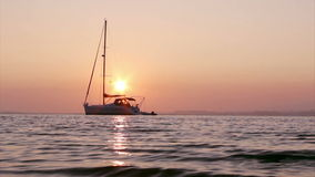 Boat silhoette at sunset in Ria Formosa. Algarve Stock Image