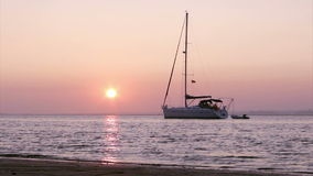 Boat silhoette at sunset in Ria Formosa. Algarve Royalty Free Stock Images