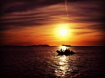 Boat Silhouette. Silhouette in Ibiza with a boat crossing the sun with a red sky Stock Photo