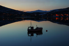 Boat silhouette in Norwegian fjords Royalty Free Stock Images