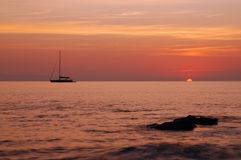 Boat silhouette and sunrise royalty free stock photo