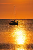 Boat silhouetted at sunset Royalty Free Stock Image