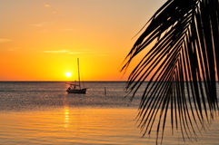 Boat silhouetted at sunset Royalty Free Stock Photo