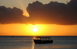 Boat silhouetted at sunset Royalty Free Stock Photography