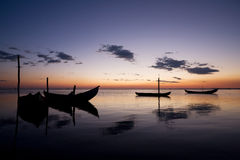 Boat Sillhouettes at Sunset royalty free stock images