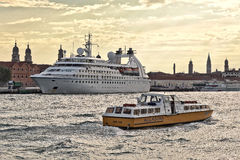 Boat Sior Elio and Cruise Ship Star Pride in Venice, Italy Stock Image