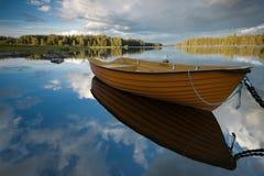 Boat on the sky. National park Fornebofjorden in Sweden Stock Image