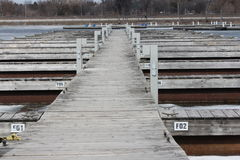 Boat Slips at Marina. Empty boat slips during the early spring season in North America Royalty Free Stock Photos
