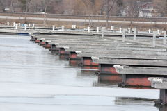 Boat Slips at Marina. Empty boat slips during the early spring season in North America. Marina almost clear of ice Stock Photography