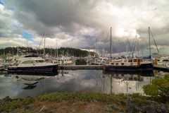 Boat Slips at Anacortes Marina in Washington State USA. Boat Slips at Port of Anacortes Cap Sante Marina on Fidalgo Island in Washington State on a cloudy day Royalty Free Stock Image