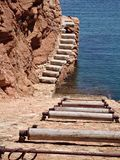 Boat slipway. Mediteranean slipway for boats with old rollers Royalty Free Stock Images
